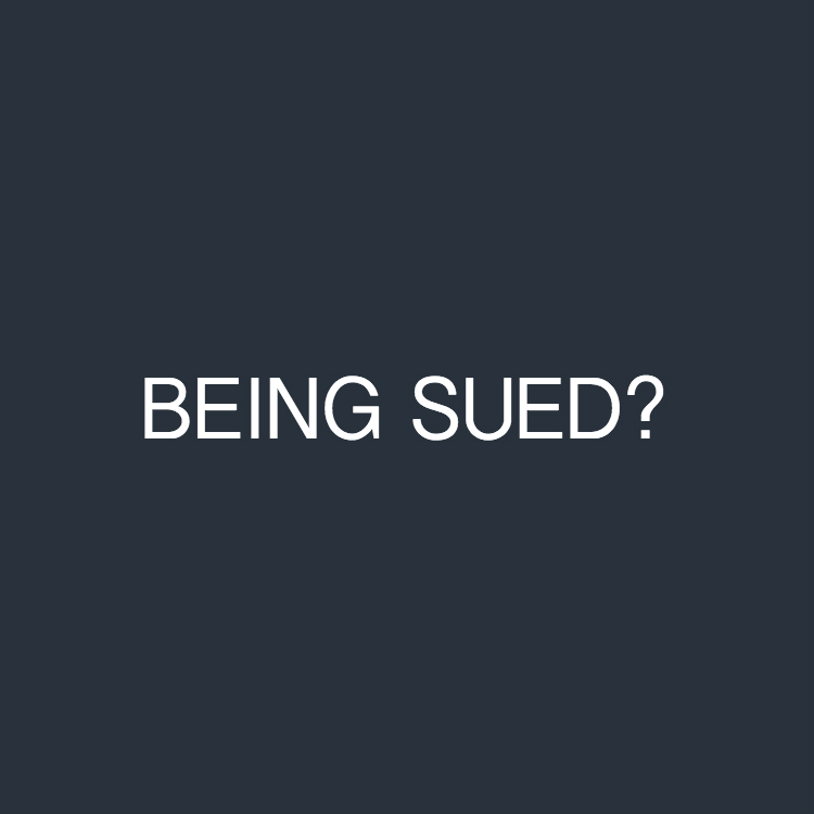 "The white font text ""BEING SUED?"" on a dark blue background"