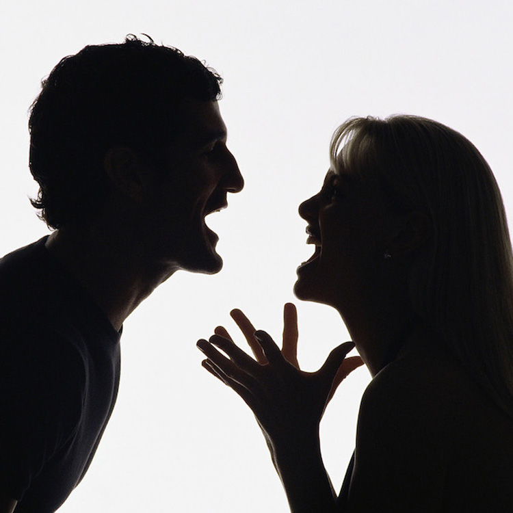 Silhouette of a man, left and woman, right, couple arguing